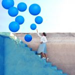 Clusters of Bright Balloons Envelop Photographer Fares Micue in Her Expressive Self-Portraits